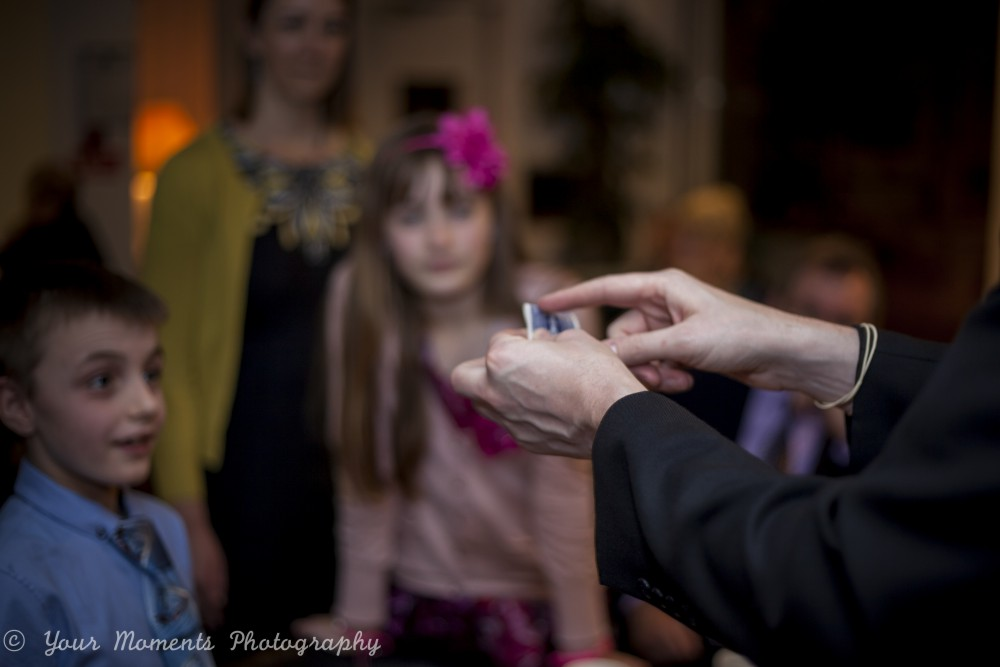 Edinburgh magician Ian Kendall holds a child spellbound at a wedding